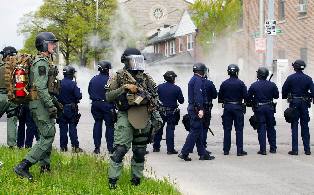 . Baltimore police officers respond to demonstrators after the funeral of Freddie Gray, Monday, April 27, 2015, in Baltimore. (AP Photo/Jose Luis Magana)
