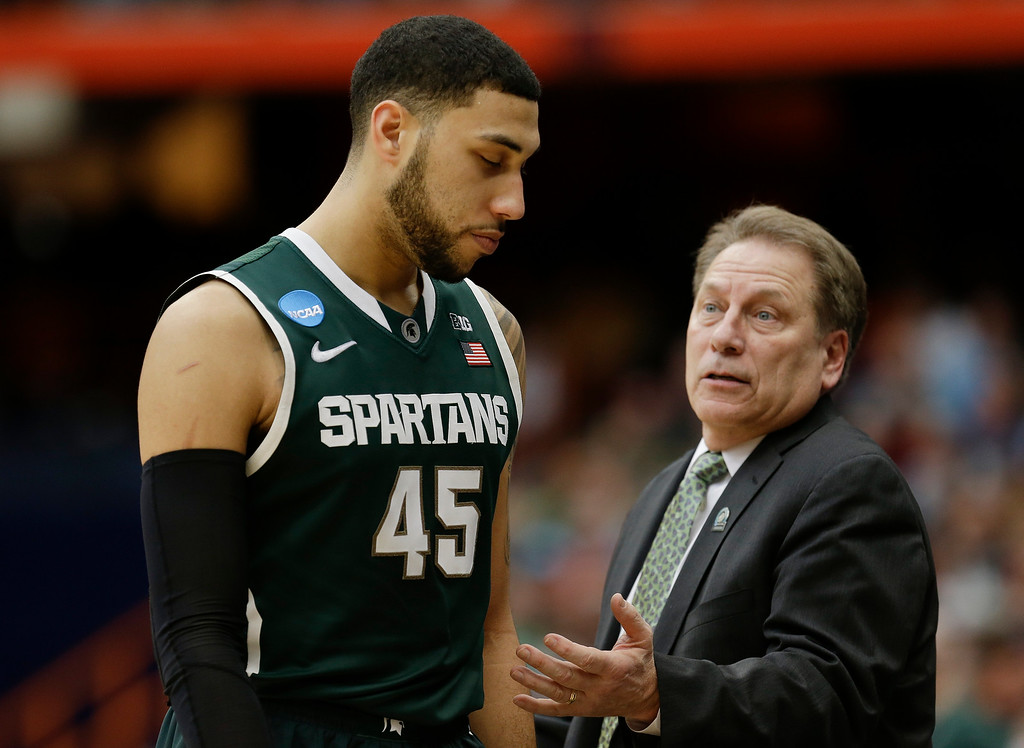 . Michigan State\'s Denzel Valentine (45) reacts to head coach Tom Izzo during the second half of a regional final against Louisville in the NCAA men\'s college basketball tournament Sunday, March 29, 2015, in Syracuse, N.Y. (AP Photo/Seth Wenig)
