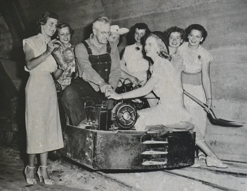. Writes STEVE KELLER: �Here is a photo taken by the KSTP news team on December 30, 1954, of my grandfather, A.P. Mitchell, with models on a photo shoot of the silica mines at Ford Motor Company in St. Paul. He worked there for close to 30 years. After the mines closed, he worked in the paint department. Please note the miner\'s lantern, and he is seated on the engine. The piece was aired on Channel 5 by Bill Ingram, titled �Behind Private Doors.� Question is this: Do any of the readers out there recognize any of the models, and are they still around? I very much would like to ask them about that day � another small part of St. Paul history gone forever. Thanks for your time.�    BULLETIN BOARD QUIBBLES (?): It�s not gone forever! It�s still right here, in the St. Paul Pioneer Press, on the 29th of June in 2013. Photographs and newsprint make the past present � not to mention permanent.