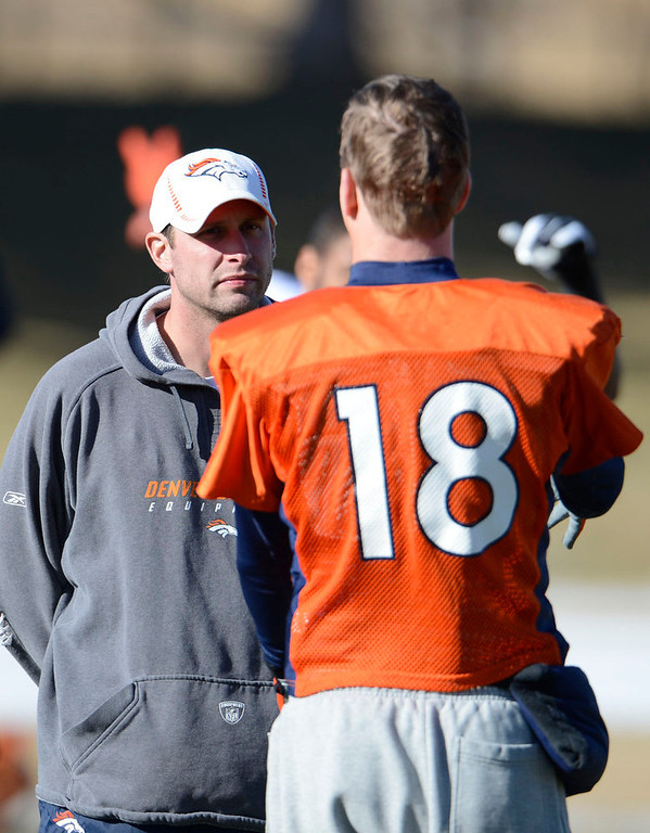 . Quarterbacks coach Adam Gase talks with Denver Broncos quarterback Peyton Manning (18) during practice Wednesday, January 9, 2013 at Dove Valley.  John Leyba, The Denver Post