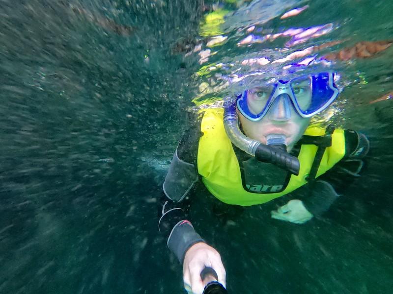 David Stock Jr of Divergent Travelers Adventure Travel Blog snorkeling in La Paz Mexico