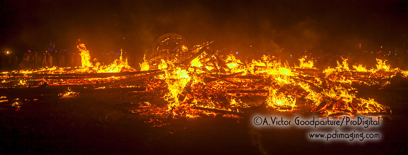 The fiery pile that 1 hour earlier was a huge wooden structure that held up The Man.
