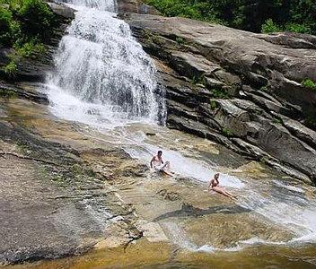 Kenny and Dana Sliding down  Big Falls on Thompson River Thompson River Gorge NC
