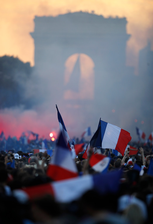 . A crowd invades the Champs Elysees avenue, with the Arc de Triomphe in background, after France won the soccer World Cup final match between France and Croatia, Sunday, July 15, 2018 in Paris. France won its second World Cup title by beating Croatia 4-2 . (AP Photo/Francois Mori)