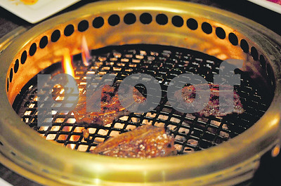 kanpai-thin-slices-of-meat-over-an-open-flame-and-good-company
