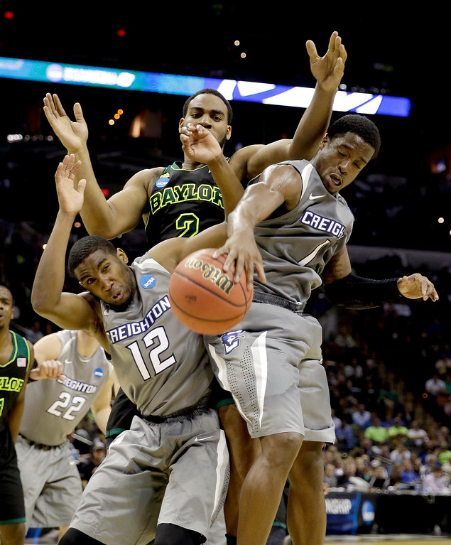 . Creighton\'s Jahenns Manigat (12) and Austin Chatman (1) reach for a rebound in front of Baylor\'s Rico Gathers (2) during the second half of a third-round game in the NCAA college basketball tournament Sunday, March 23, 2014, in San Antonio. Baylor won 85-55. (AP Photo/David J. Phillip)