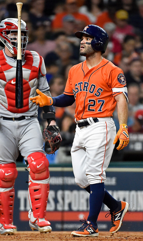 . Houston Astros\' Jose Altuve flips his bat after striking out during the third inning of a baseball game against the Cleveland Indians, Friday, May 19, 2017, in Houston. (AP Photo/Eric Christian Smith)