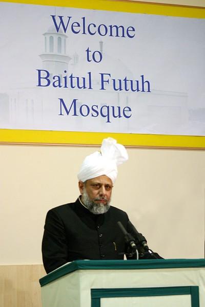 Hazrat Khalifatul Masih V addressing distinguished guests