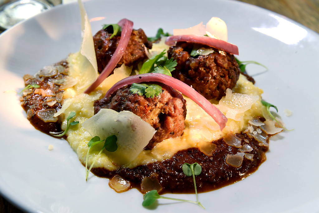 . DENVER, CO - APRIL 21:  Lamb meatballs with  yellow corn grits,  mole,  cilantro, and  asadero at  Grind Kitchen + Watering Hole in Cherry Creek North  in Denver on Thursday, April 21, 2016.  (Photo by Cyrus McCrimmon/ The Denver Post)
