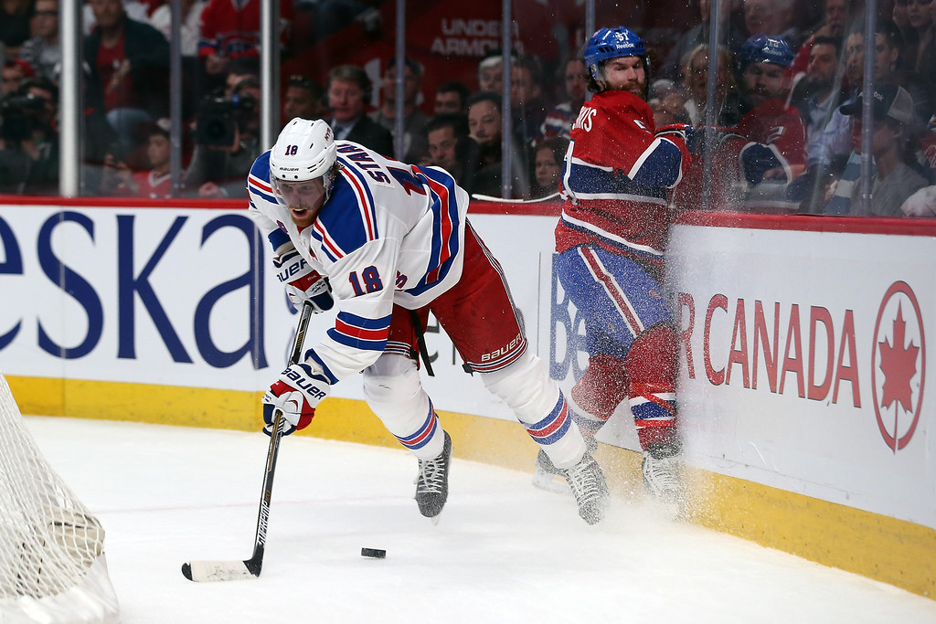 . Marc Staal #18 of the New York Rangers skates with the puck against Montreal Canadiens during Game Two of the Eastern Conference Final during the 2014 Stanley Cup Playoffs at Bell Centre on May 19, 2014 in Montreal, Canada.  (Photo by Bruce Bennett/Getty Images)