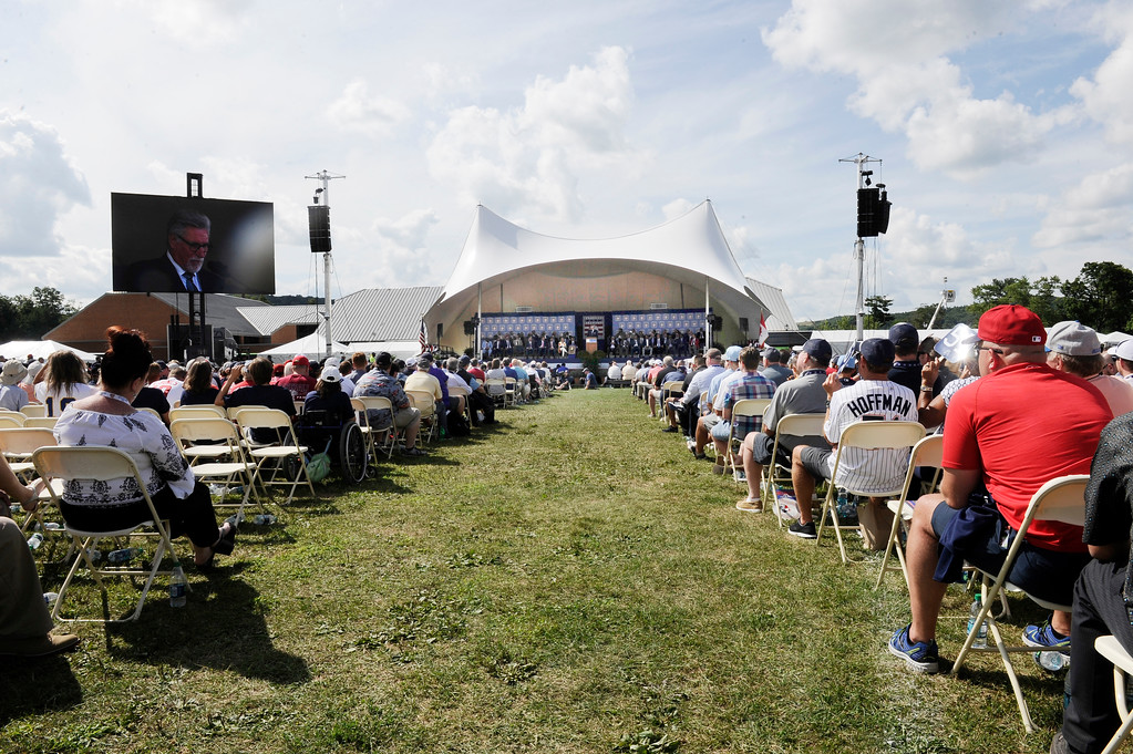 . Fans watch during an National Baseball Hall of Fame induction ceremony at the Clark Sports Center on Sunday, July 29, 2018, in Cooperstown, N.Y. (AP Photo/Hans Pennink)