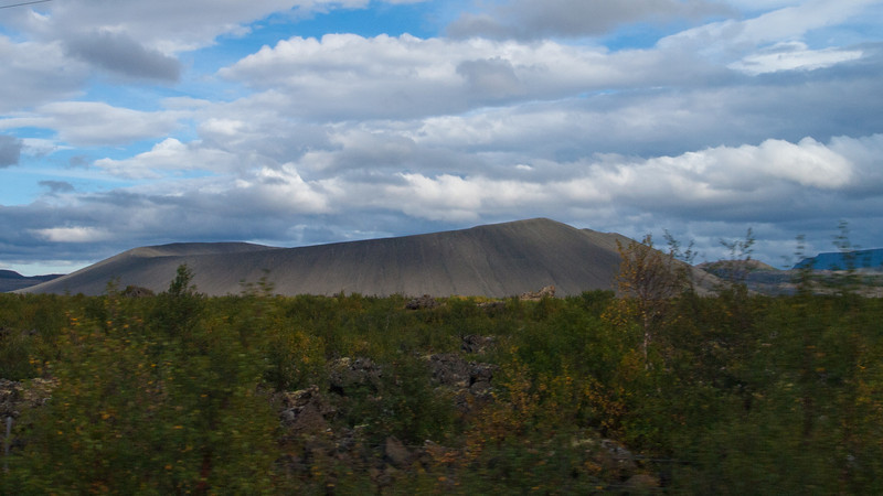 view of Hverfjall volcano as we are driving down the road