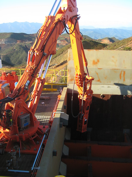 NPK B7500 pedestal boom system with GH9 hydraulic hammer-breaking bridged rock at grizzly crusher in quarry (5).jpg