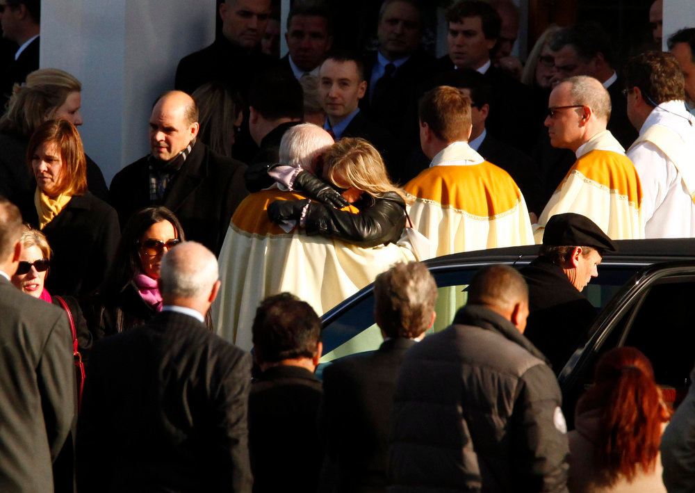 Description of . People hug at the funeral of six-year-old student Caroline Previdi, a victim of the shooting at Sandy Hook Elementary School in Sandy Hook Village in Newtown, Connecticut, December 19, 2012. Six victims of the Newtown school shooting will be honored at funerals and remembrances on Wednesday. REUTERS/Eric Thayer