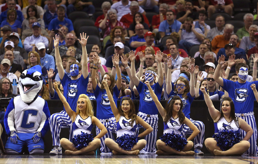 . The Creighton Bluejays cheerleaders and mascot look on in the second half against the Louisiana Lafayette Ragin Cajuns during the second round of the 2014 NCAA Men\'s Basketball Tournament at AT&T Center on March 21, 2014 in San Antonio, Texas.  (Photo by Ronald Martinez/Getty Images)