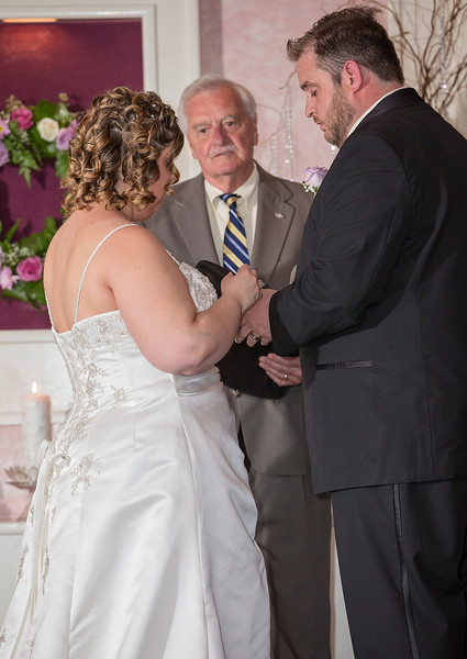 Putting a ring on the groom.jpg