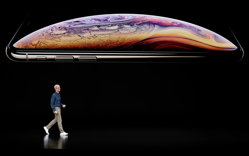 . Apple CEO Tim Cook speaks about the Apple iPhone XS at the Steve Jobs Theater during an event to announce new Apple products Wednesday, Sept. 12, 2018, in Cupertino, Calif. (AP Photo/Marcio Jose Sanchez)