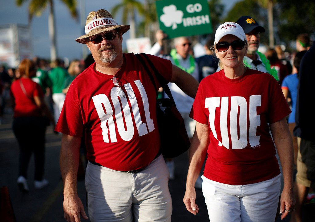 . Alabama Crimson Tide fans wear Roll Tide shirts outside Sun Life stadium before the BCS National Championship college football game between Alabama and the Notre Dame Fighting Irish in Miami, Florida January 7, 2013. REUTERS/Mike Segar