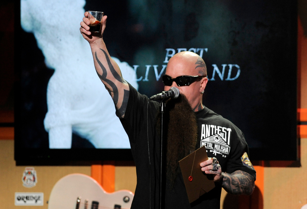 . Kerry King of the band Slayer offers a toast to late bandmate Jeff Hanneman, who died Thursday of liver failure, during the 2013 Revolver Golden Gods Award Show at Club Nokia on Thursday, May 2, 2013 in Los Angeles. (Photo by Chris Pizzello/Invision/AP)