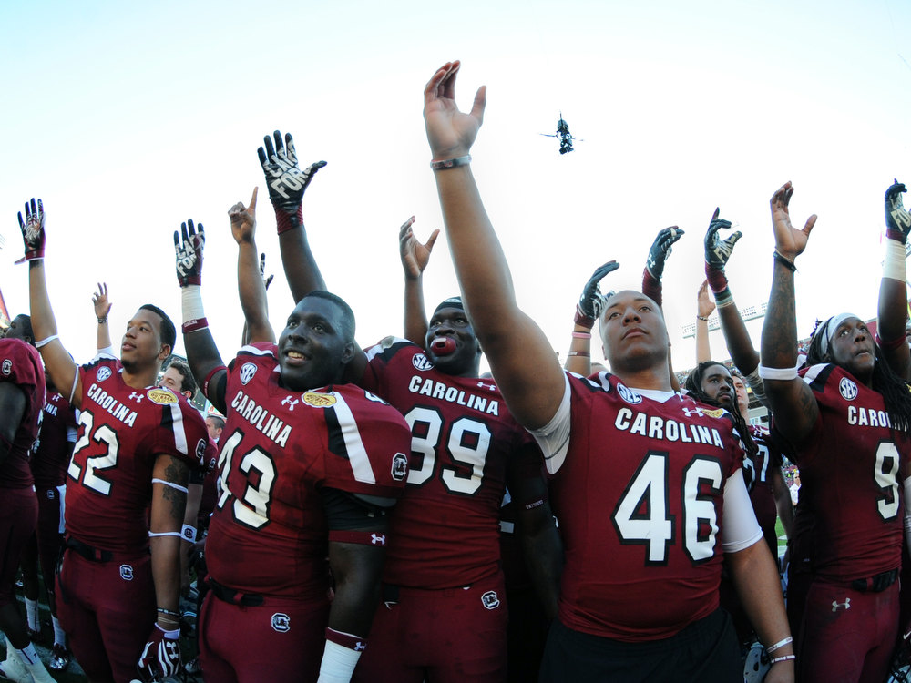 . Players of the South Carolina Gamecocks salute their fans after a 33 - 28  victory against the Michigan Wolverines in the Outback Bowl January 1, 2013 at Raymond James Stadium in Tampa, Florida.  (Photo by Al Messerschmidt/Getty Images)