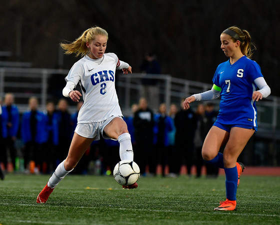 11/23/2019 Mike Orazzi | Staff Glastonbury's Chloe Landers (8) and Southington High School's Emma Panarella (7) during the Class LL Girls State Soccer Tournament at Veterans Stadium in New Britain Saturday evening. Glastonbury defeated Southington 1-0.