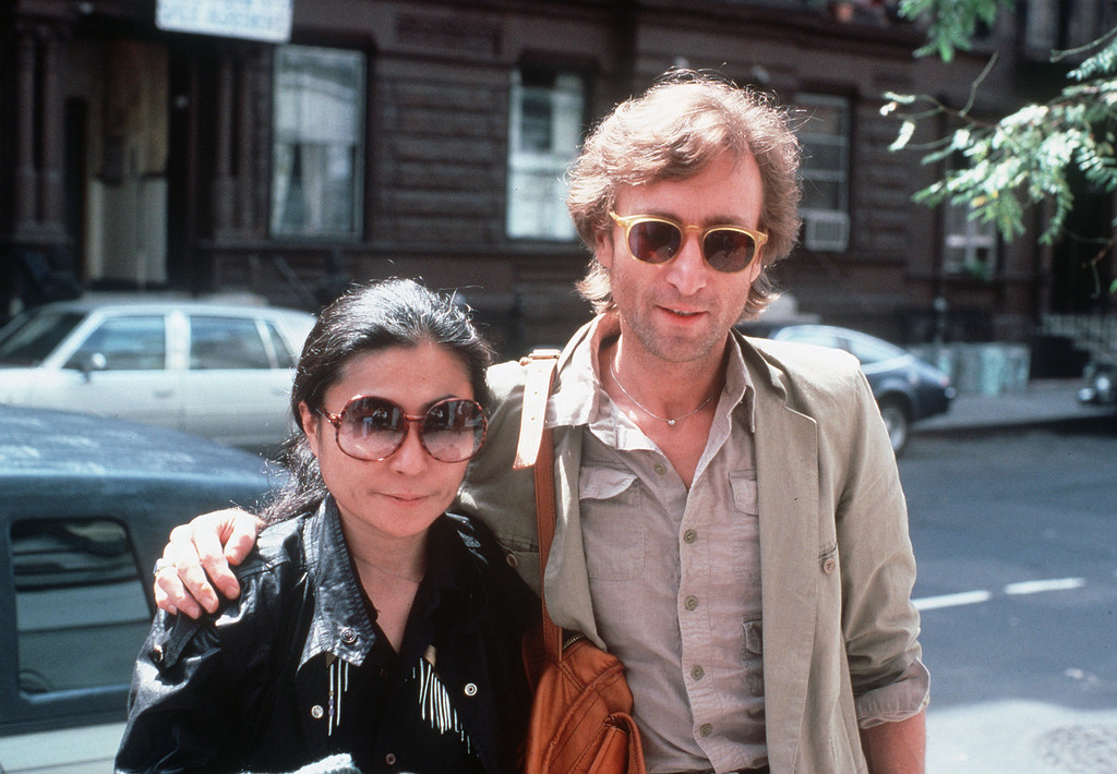 . John Lennon and his wife, Yoko Ono, arrive at The Hit Factory, a recording studio in New York City on Aug. 22, 1980.  (AP Photo/Steve Sands)