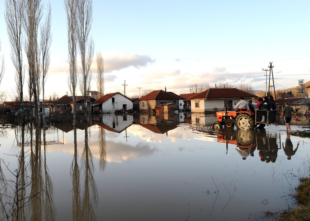 Description of . Women are evacuated on a tractor in the flooded town of Sveti Nikole, some 60 kilometers northeast from Skopje on February 26, 2013. Torrential rains in the last three days caused dozens of floods, affecting many villages and towns, and damaging crops. ROBERT ATANASOVSKI/AFP/Getty Images