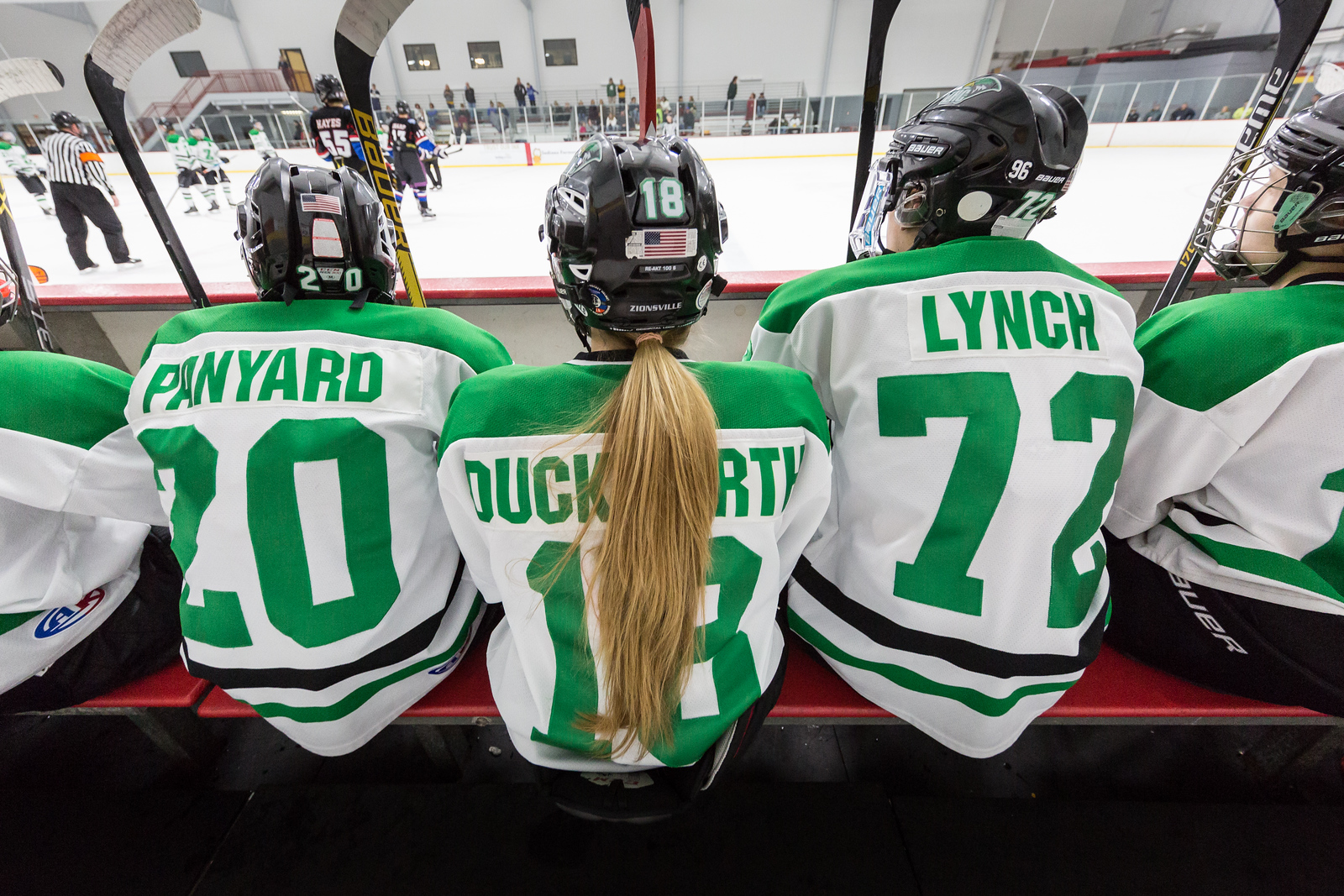 Ponytail at a hockey game...love it.