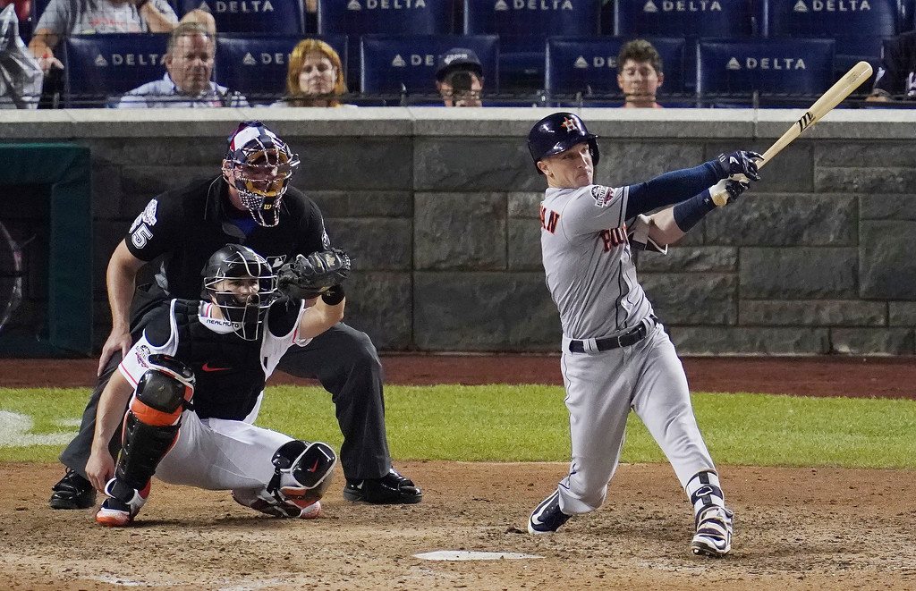 . Houston Astros Alex Bregman (2) hits a solo home run during the 89th MLB baseball All-Star Game, Tuesday, July 17, 2018, at Nationals Park, in Washington. The American League won 8-6. (AP Photo/Carolyn Kaster)