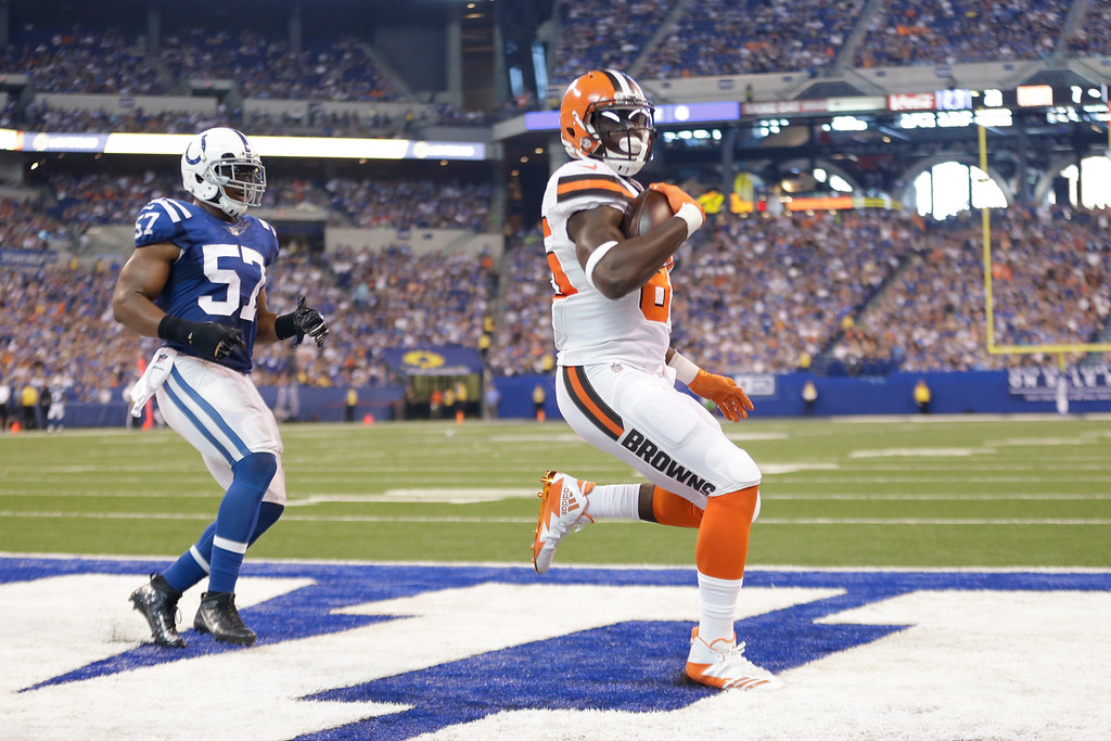 . Cleveland Browns tight end David Njoku (85) makes a catch for a touchdown in front of Indianapolis Colts inside linebacker Jon Bostic (57) during the first half of an NFL football game in Indianapolis, Sunday, Sept. 24, 2017. (AP Photo/AJ Mast)