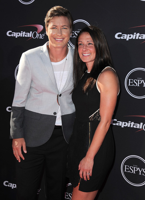 . Soccer player Abby Wambach, left, and a guest arrive at the ESPY Awards on Wednesday, July 17, 2013, at Nokia Theater in Los Angeles. (Photo by Jordan Strauss/Invision/AP)