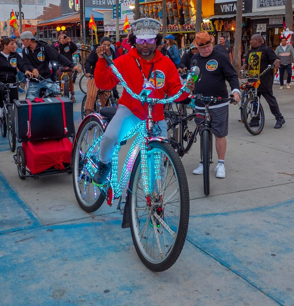 Night time bicycle ride with costumed riders and led lights