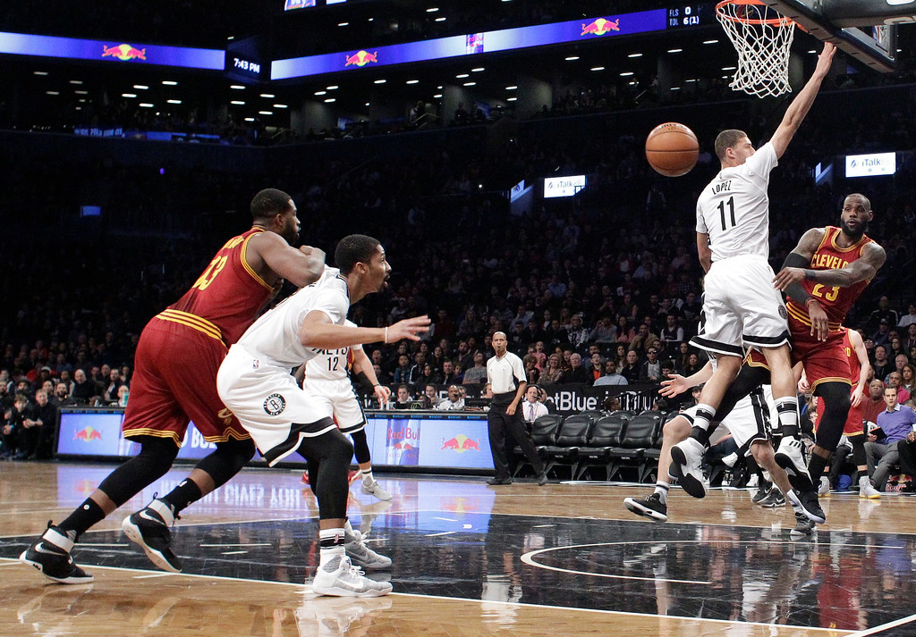 . Cleveland Cavaliers\' LeBron James (23) passes away from Brooklyn Nets\' Brook Lopez (11) during the first half of an NBA basketball game Friday, Jan. 6, 2017, in New York. (AP Photo/Frank Franklin II)