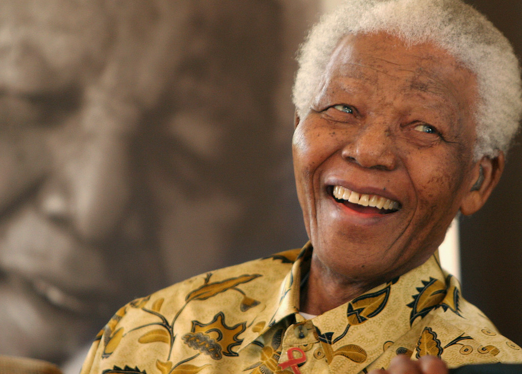 . In this Dec. 7, 2005 file photo, former South African President Nelson Mandela, 87, smiles the Mandela Foundation in Johannesburg. On Thursday, Dec. 5, 2013, Mandela died at the age of 95. (AP Photo/Denis Farrell, File)