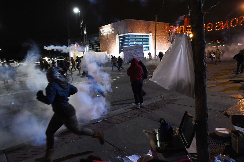. Demonstrators flee as police fire tear gas during a demonstration to protest the death 18-year-old Michael Brown in Ferguson, Missouri, on November 24, 2014. US President Barack Obama urged calm on November 24 as violent protests broke out on the streets of Ferguson after a grand jury decided a white policeman will not face charges for killing a black teen. JEWEL SAMAD/AFP/Getty Images