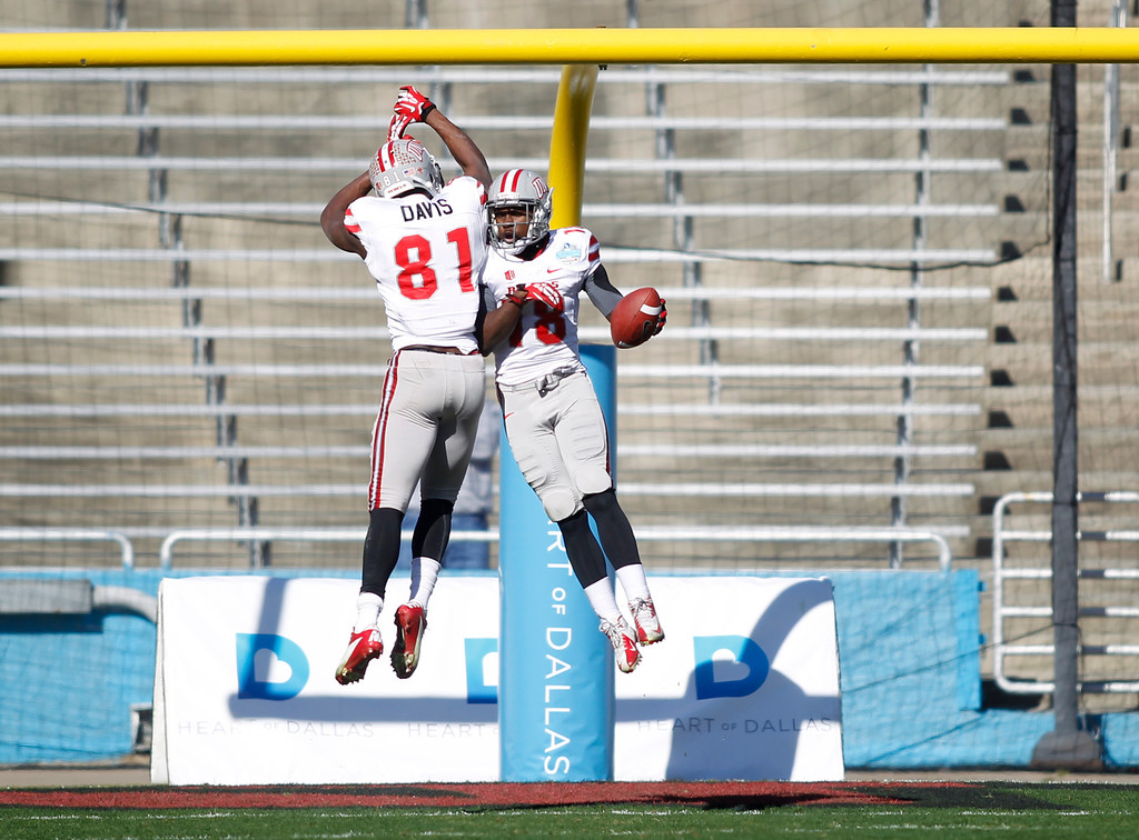 . UNLV wide receiver Marcus Sullivan (18) celebrates his touchdown reception against North Texas with wide receiver Devante Davis (81) during the first half of the Heart of Dallas NCAA college football game, Wednesday, Jan. 1, 2014, in Dallas. (AP Photo/Mike Stone)