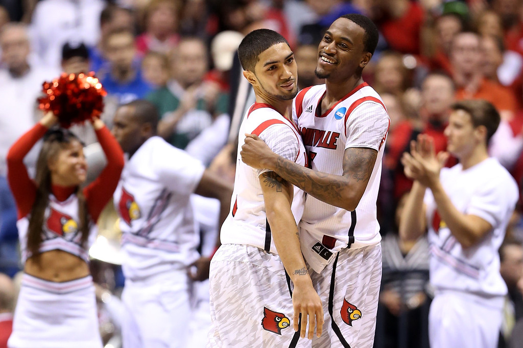 . (L-R) Russ Smith #2 and Kevin Ware #5 of the Louisville Cardinals celebrate after they won 77-69 against the Oregon Ducks during the Midwest Region Semifinal round of the 2013 NCAA Men\'s Basketball Tournament at Lucas Oil Stadium on March 29, 2013 in Indianapolis, Indiana.  (Photo by Andy Lyons/Getty Images)