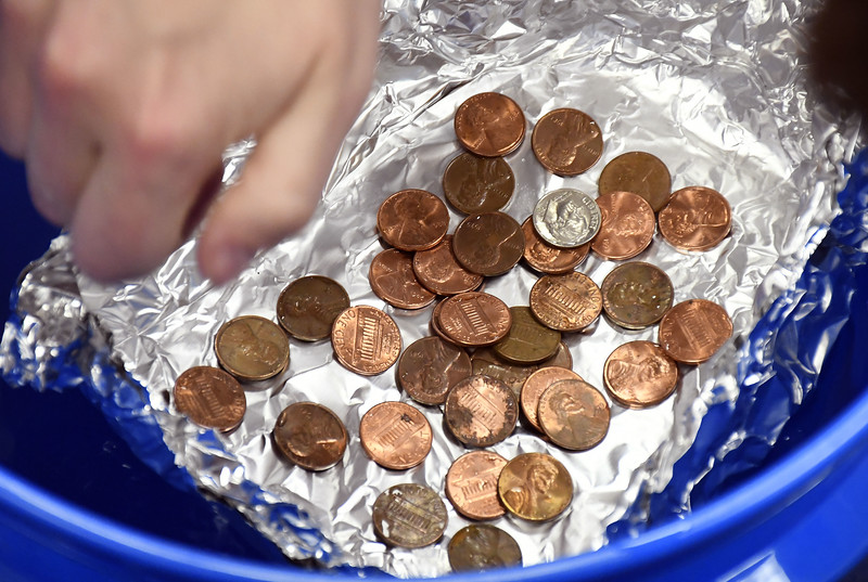 5/11/2018 Mike Orazzi | Staff Students drop pennies onto a foil boat during a  Science, Technology, Engineering, Art, Math held Friday morning at the South Side School in Bristol.