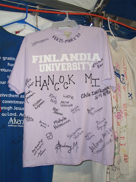 "T-shirts adorn the interior of the ""dining tent"" at Camp Atonement, Metairie, La. It has become tradition for volunteers to sign and leave behind a t-shirt representing their school and/or home congregation. Finlandia University is one of 28 colleges and universities of the ELCA."