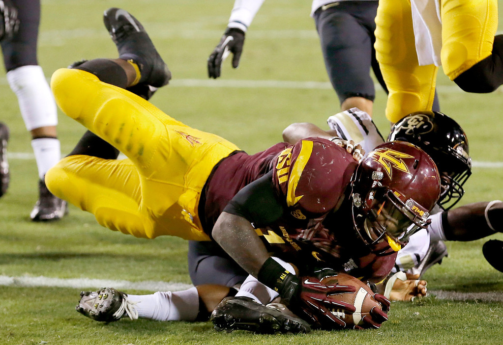 . Arizona State\'s Marion Grice, front, dives for the end zone but is stopped short by Colorado\'s Chidobe Awuzie during the first half of an NCAA college football game on Saturday Oct. 12, 2013, in Tempe, Ariz. (AP Photo/Ross D. Franklin)