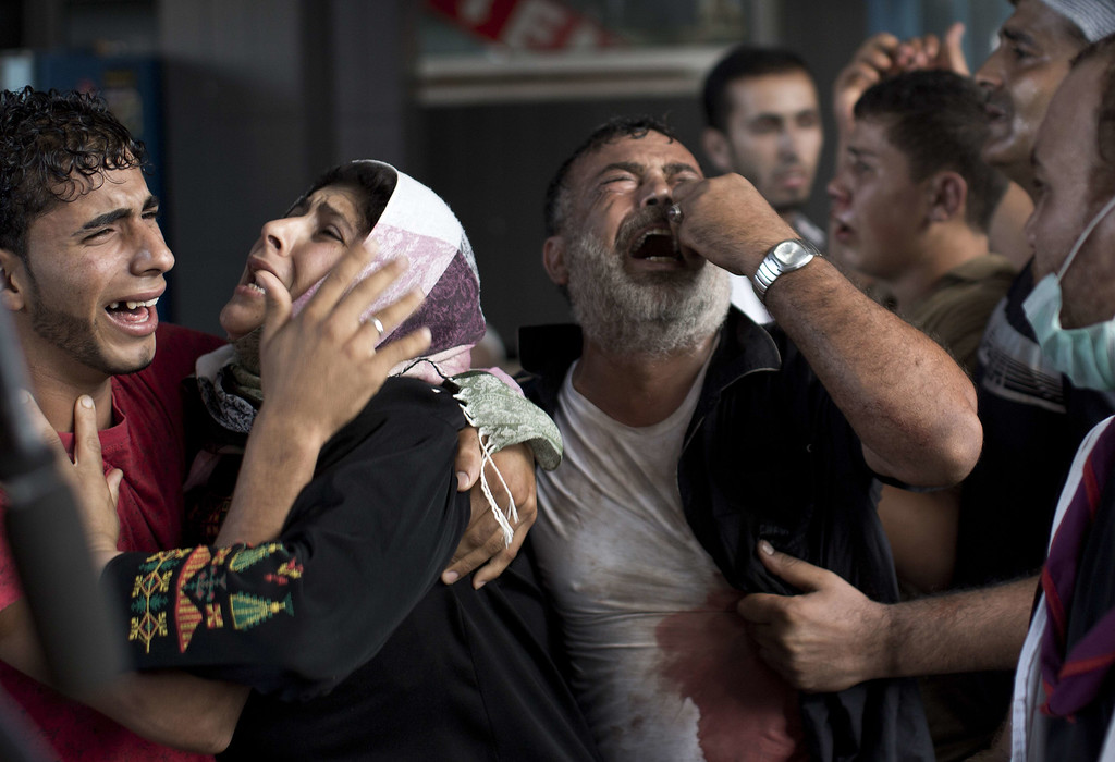 . Palestinian mourners cry at Gaza City\'s al-Shifa hospital after an explosion killed at least seven children in a public playground in the beachfront Shati refugee camp on July 28, 2014. Palestinian medical sources blamed the killings on air strikes launched by the Israeli military, which in turn said Hamas had misfired its own rockets at the camp and at the Shifa hospital.  AFP PHOTO/MAHMUD  HAMS/AFP/Getty Images