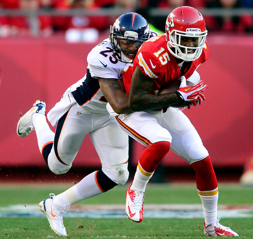 . Chris Harris (25) of the Denver Broncos tackles A.J. Jenkins (15) of the Kansas City Chiefs during the first half of action at Arrowhead Stadium.   (Photo by AAron Ontiveroz/The Denver Post)