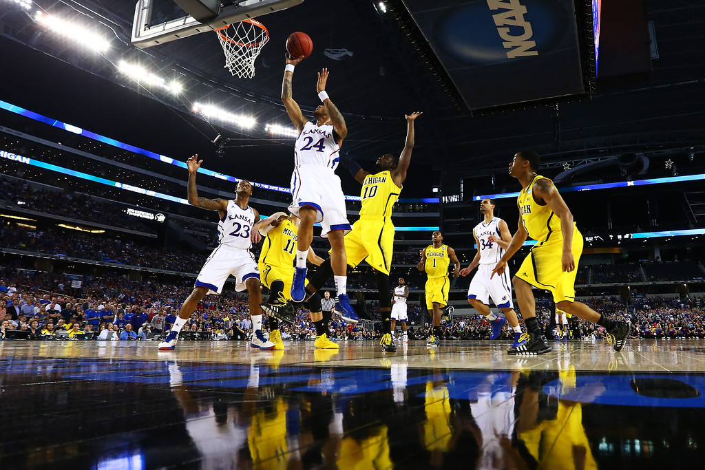 . ARLINGTON, TX - MARCH 29:  Travis Releford #24 of the Kansas Jayhawks shoots against the Michigan Wolverines in the first half during the South Regional Semifinal round of the 2013 NCAA Men\'s Basketball Tournament at Dallas Cowboys Stadium on March 29, 2013 in Arlington, Texas.  (Photo by Tom Pennington/Getty Images)