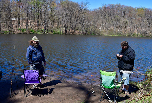4/24/2019 Mike Orazzi | Staff Brian Borry and Joe Onorato while fishing at Birge Pond in Bristol on Wednesday afternoon.