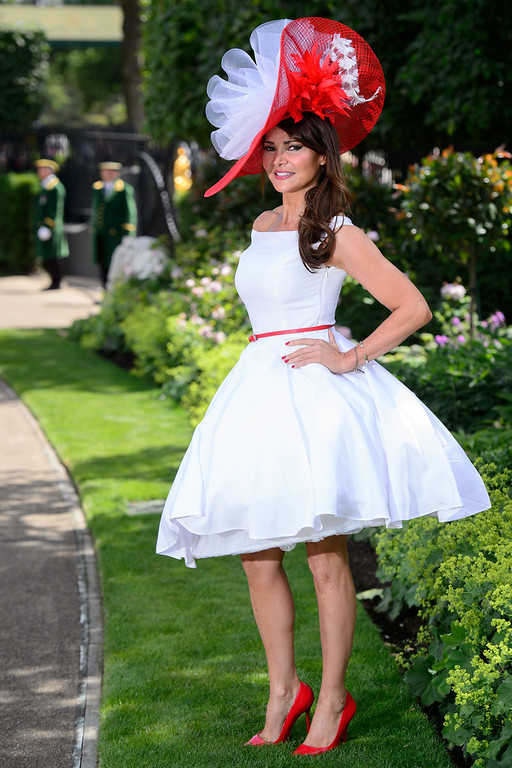 . A woman poses on the first day of Royal Ascot, in Berkshire, west of London, on June 17, 2014.  AFP PHOTO / LEON NEAL/AFP/Getty Images