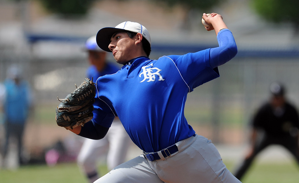 . El Rancho starting pitcher Marcus Price throws to the plate in the first inning of a CIF-SS semifinal prep playoff baseball game against Baldwin Park at Baldwin Park High School on Tuesday, May 28, 2013 in Baldwin Park, Calif.  El Rancho won 5-4.  (Keith Birmingham/Pasadena Star-News)