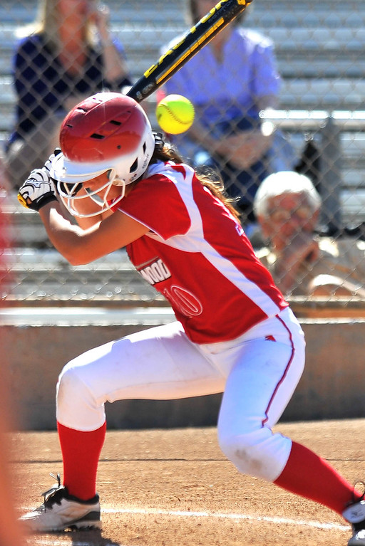 . LONG BEACH - 04/09/2013  (Photo: Scott Varley, Los Angeles Newspaper Group)  Lakewood vs Wilson girls softball at Joe Rodgers Field. Lakewood\'s Ari Burns ducks to avoid a high pitch.