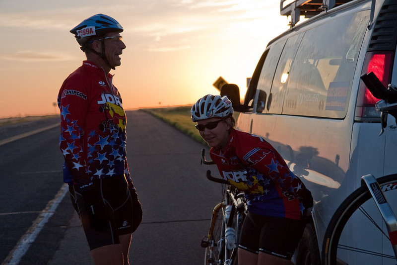Chatting at dawn, waiting for a rider exchange.