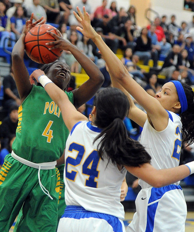 . \\tp4n\\ drives to the basket against Bishop Amat\'s Jennifer Vasquez (24) in the first half of a CIF State Southern California Regional semifinal basketball game at Bishop Amat High School on Tuesday, March 12, 2013 in La Puente, Calif. Long Beach Poly won 52-34.  (Keith Birmingham Pasadena Star-News)