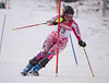 Alice Williamson hits a gate in the U16 Slalom race at Bosquet Ski Area on February 2, 2014.